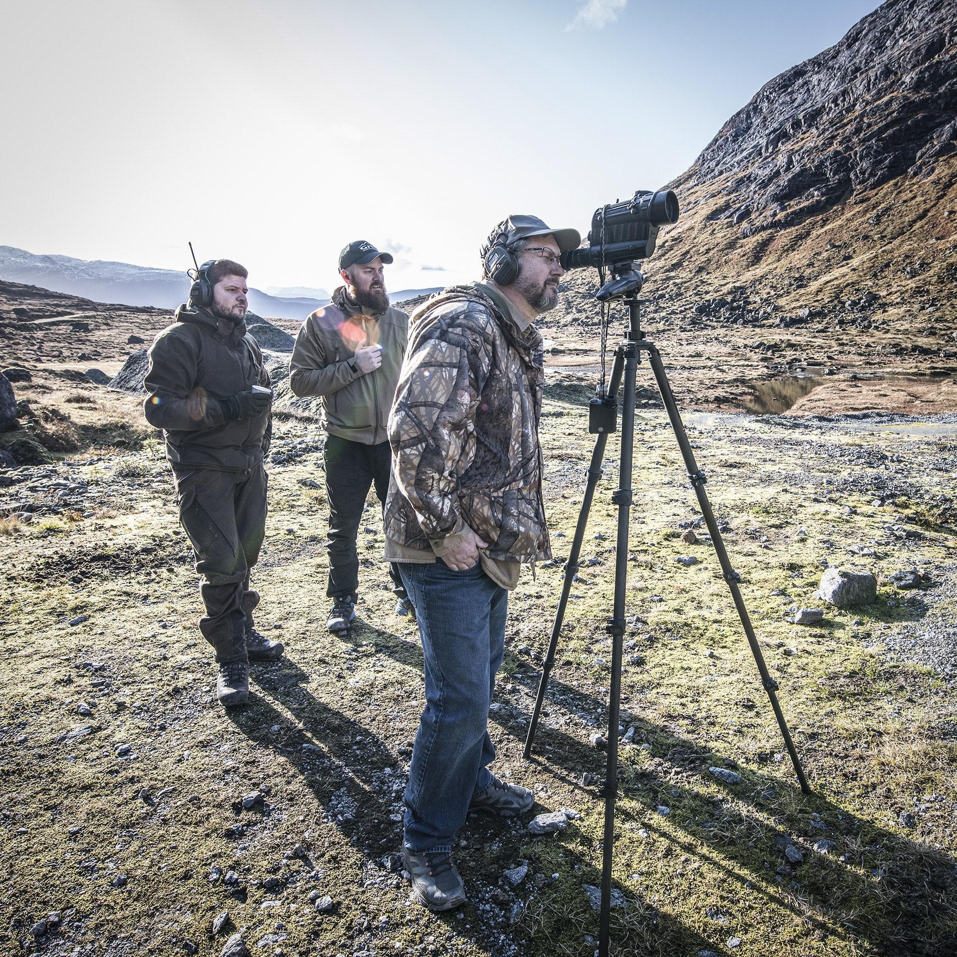 Photo of GRS Oscar, Eivind, Jerry, measuring distances on range