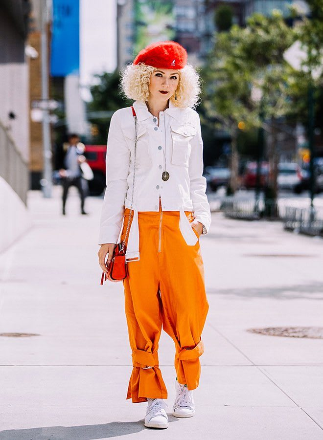 Leni is walking in the sunlight on a street in New York, wearing Stan Smith and colorful pants. Blogger; Creativity; New York; adidas; GamePlan A; Paperboats; Color; City; Inspiration