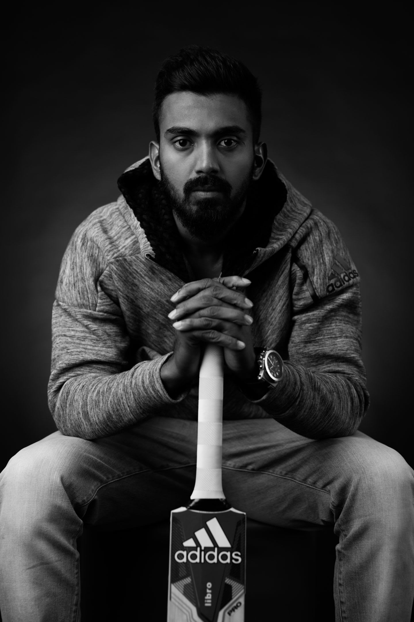 Black and white photo of Indian cricket player K.L. Rahul sitting and holding his racket, adidas-cricket-K.L.-Rahul-mindset-business-concentration-What's-Your-Gameplan, adidas, cricket, India