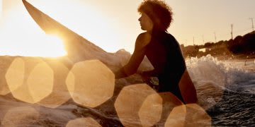 Surfer on the ocean waiting for waves during sunset. character traits, business, job, career, GamePlan A, humans, personality, positivity, self-confidence