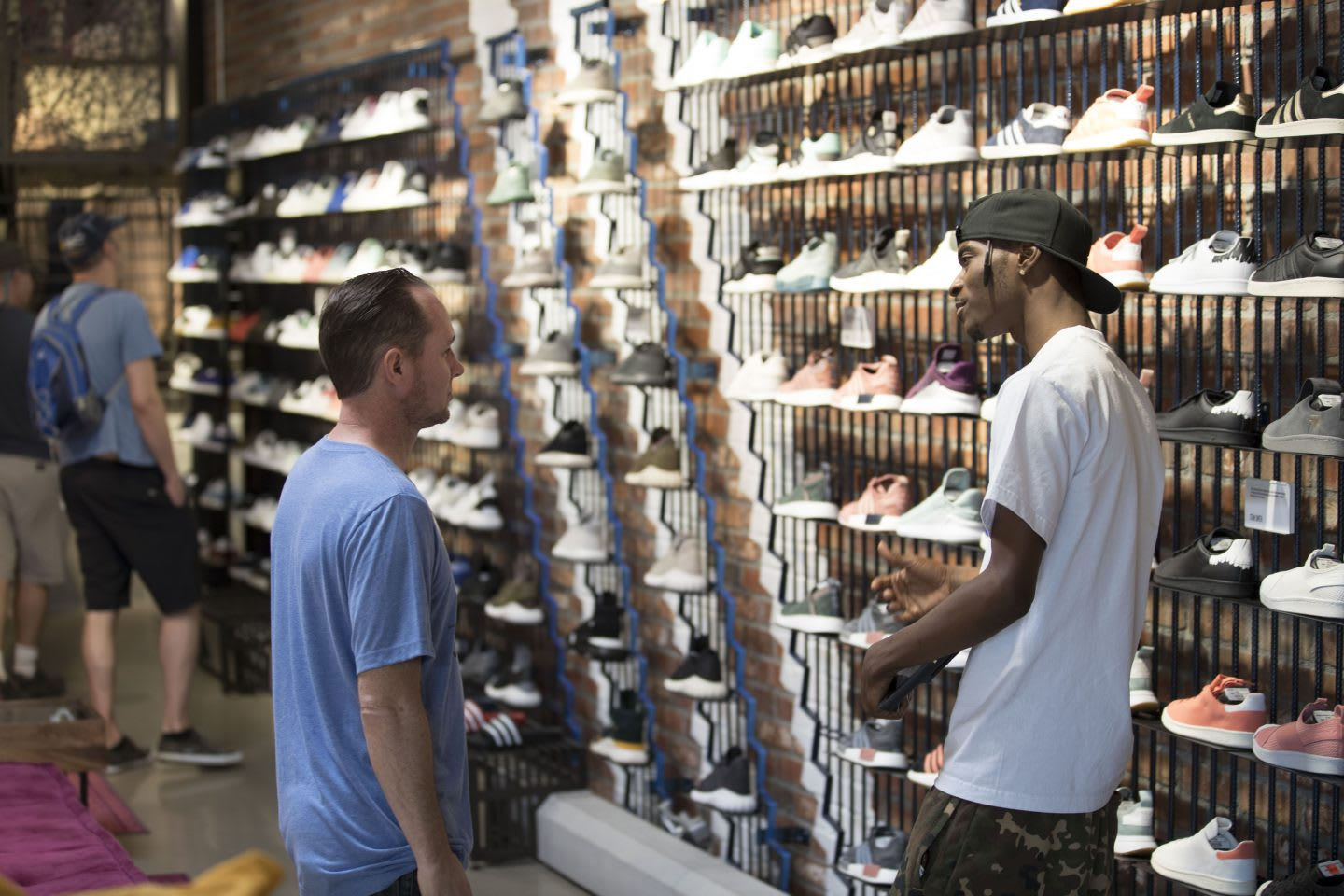 Customer and staff member talking in an adidas Originals store in Los Angeles, LA, key city, adidas, GamePlan A, communities, corporate social responsibility, creativity, individuality