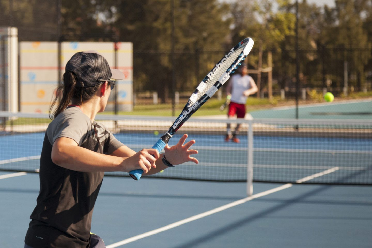 Two people playing tennis on a sunny day.Tennis, sports, fitness, motivation, team.