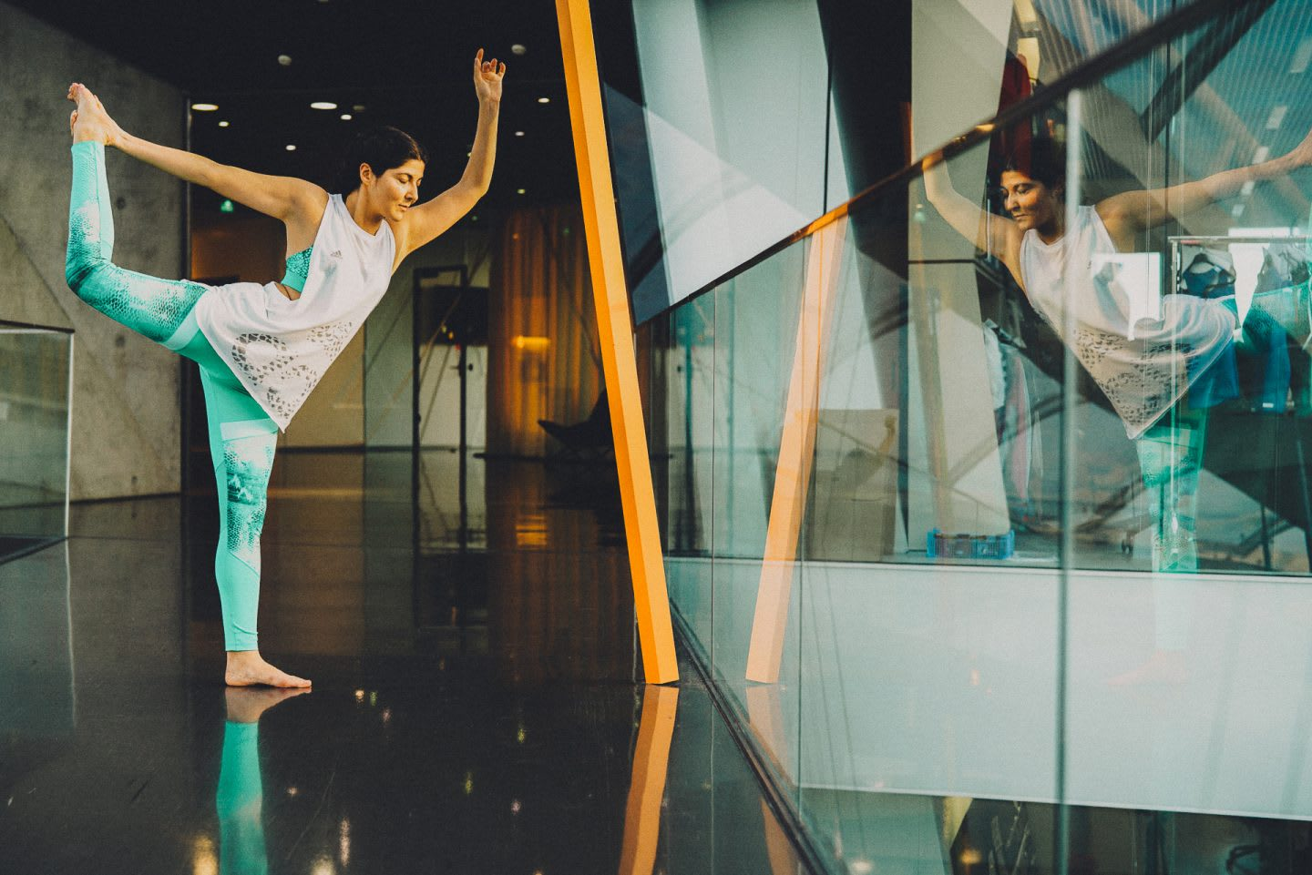 A female yogi doing the Dancer pose in an office building at adidas. adidas employee, flow, creativity, leadership, team, GamePlan A, sports, business, mindset