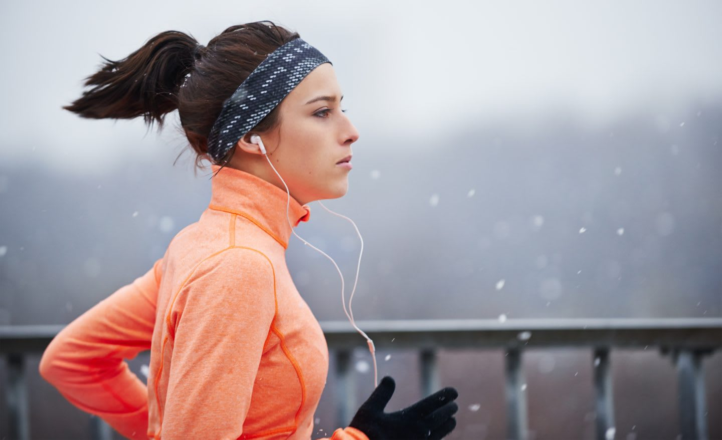 Cropped shot of a young woman running in the snow. running, outdoors, motivation, fitness, snowing.