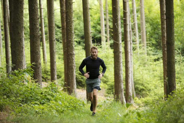 A man runs through a forest. running, fitness, outdoors, nature.