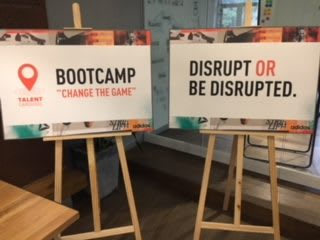 Two posters standing on easels at a bootcamp. adidas, talent program, disruption, coaching, leadership, Shanghai