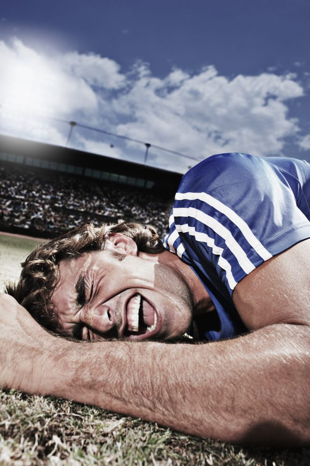 Frustrated soccer player laying on ground. soccer, pain, failure, fall, defeat, injury, GamePlan A