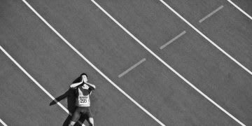 Tired runner laying on track. track, athlete, growth mindset, failure and success, Gameplan A, Adidas