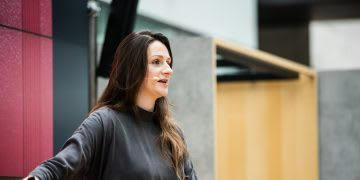 A woman presenting on stage at the adidas HQ. Lauren Currie, entrepreneur, public speaking, diversity, GamePlanA, empowerment, women, confidence, career