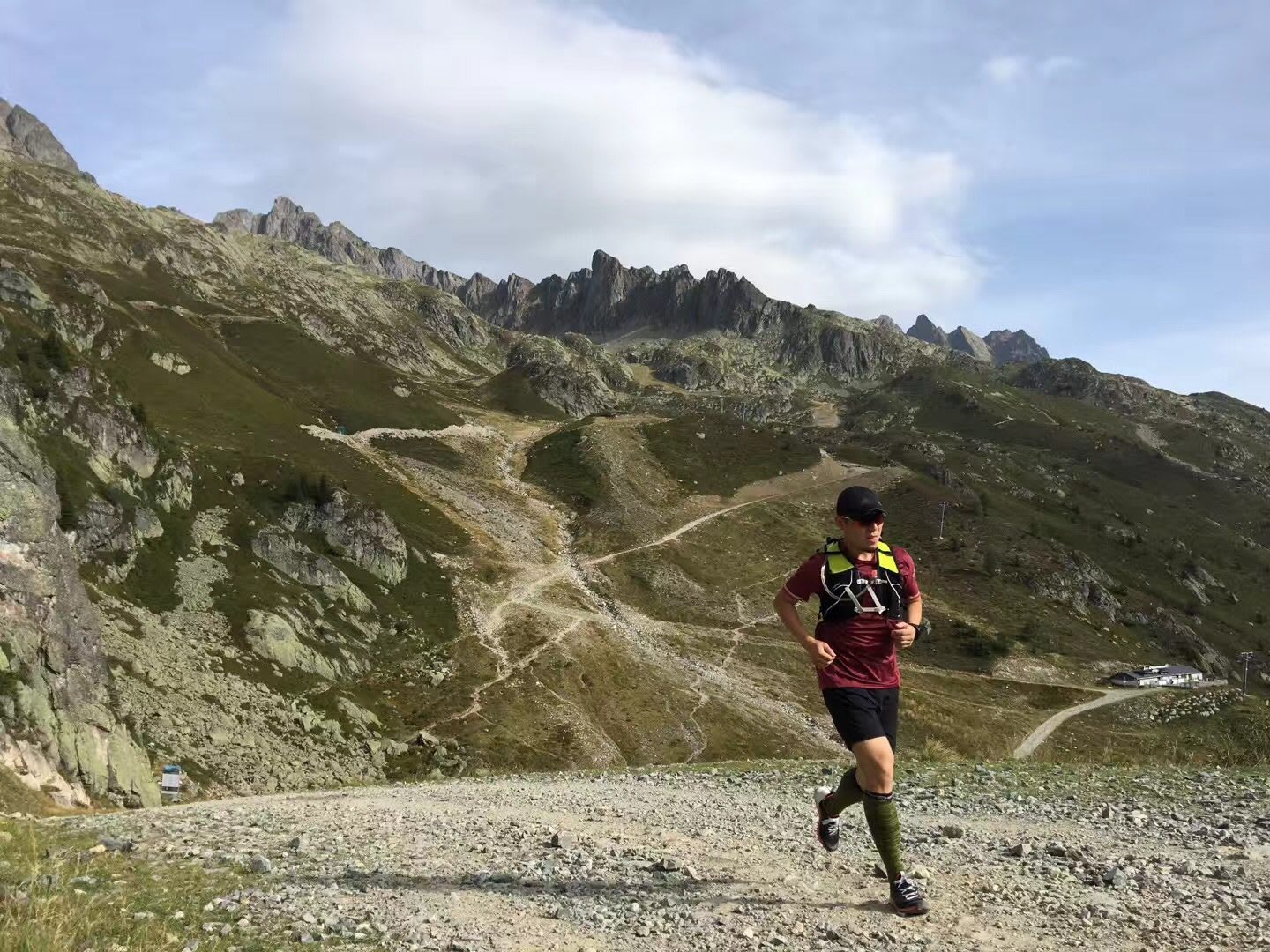 A man runs alone across a rocky terrain on top of a valley. run, running, training, ,motivation,