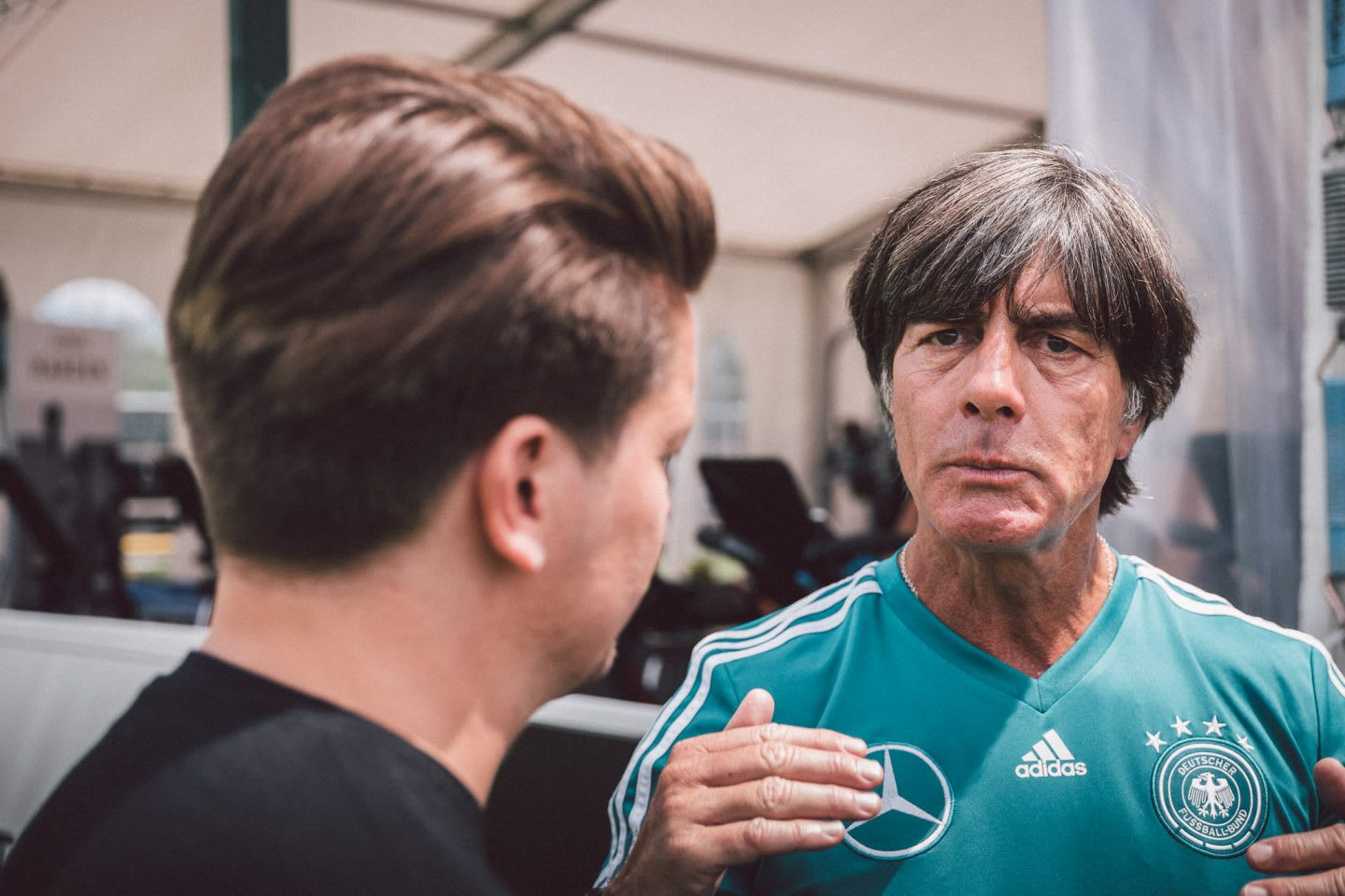 Germany national team coach Joachim Löw talking to a Sports Marketing Manager from adidas. GamePlan A, team, success, 2018 FIFA World Cup Russia, leadership, World Champions