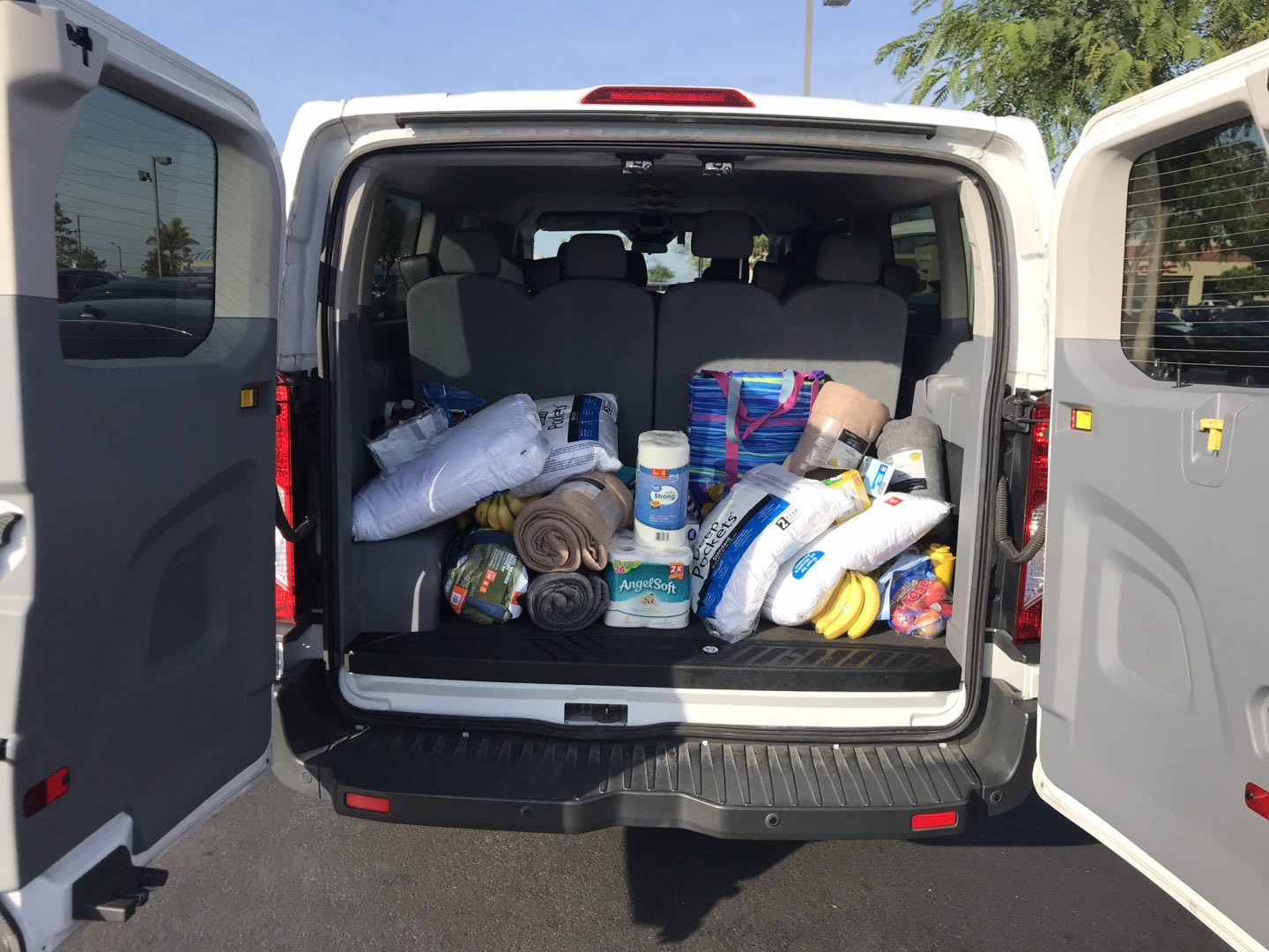 A white van is filled with running supplies. supplies, preparation,