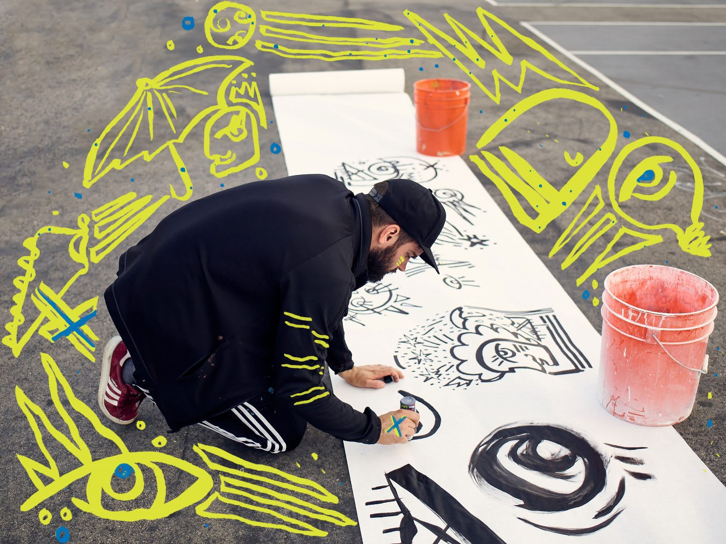An artist begins his drawings on a large piece of white paper rolled across the street. art, artist, creator, creativity, drawing, doodle