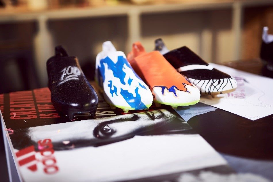 Self designed football boots are lined up together. football, design, creator, creativity
