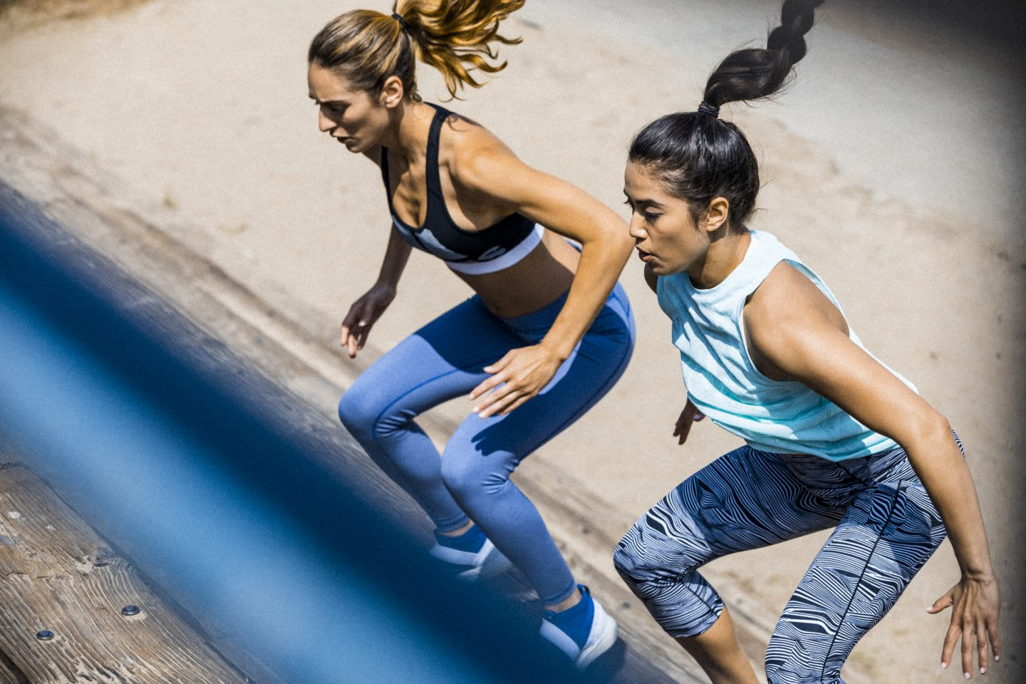 Two women partnering up for a workout.