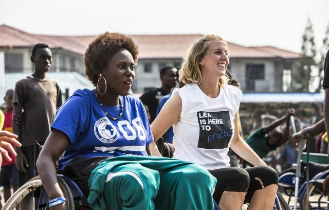 Two women sitting in wheelchairs during a wheelchair basketball game in Congo. volunteering, adidas, leadership, leadership skills