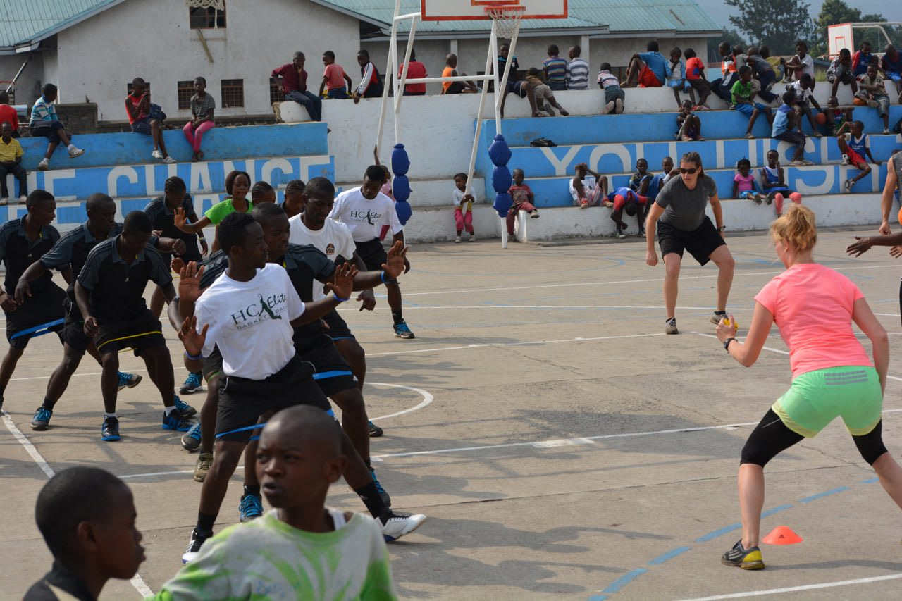 A group of African kids working out with two volunteers from adidas. volunteering, adidas, leadership, leadership skills