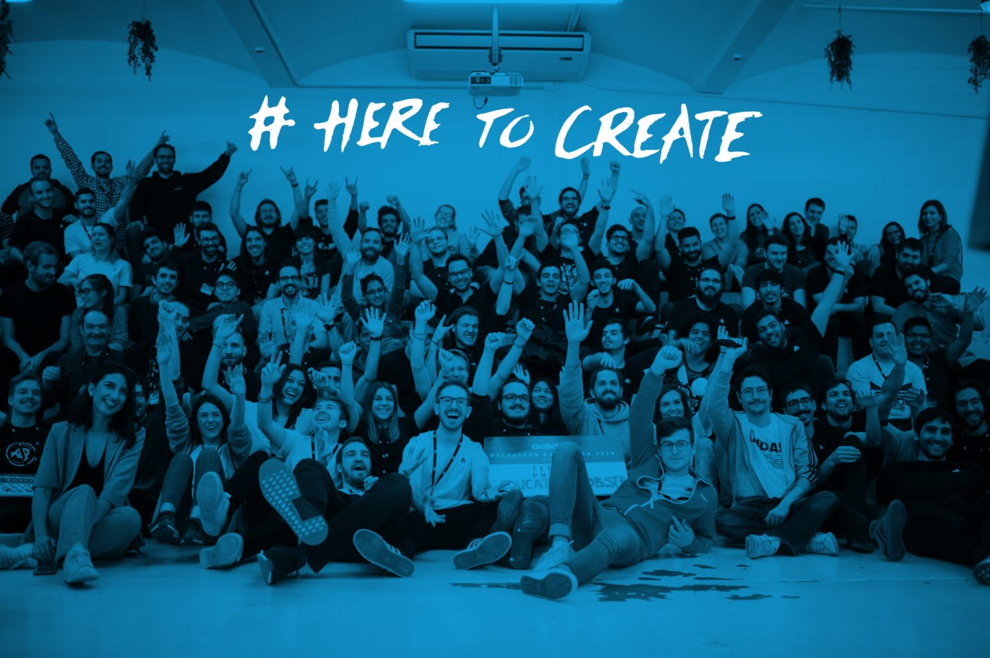 Participants of a Hackathon stand together for group picture cheering in´the camera, digital, ideas, innovation, technology, hackathon, coding, group, team work, project, adidas, GamePlan A