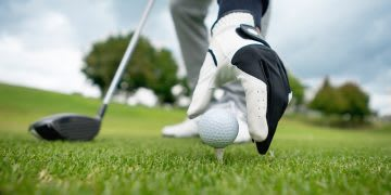 Close-up on a golfer placing the ball on the golf tee, golf, golf course, outdoor sports, golf player, close up, GamePlan A