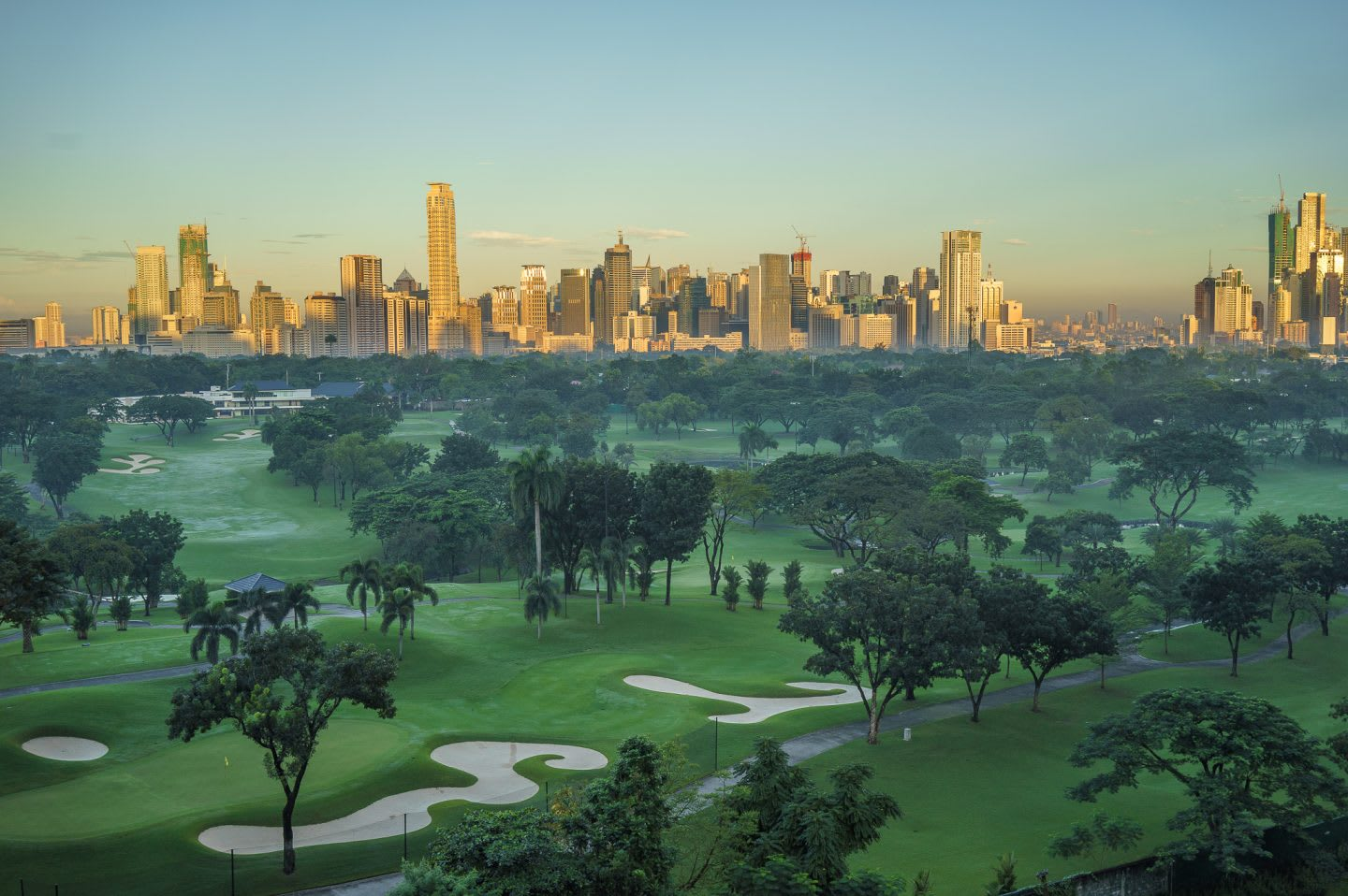 Golf course and city against blue sky, golf, golf course, skyline, sport, GamePlan A