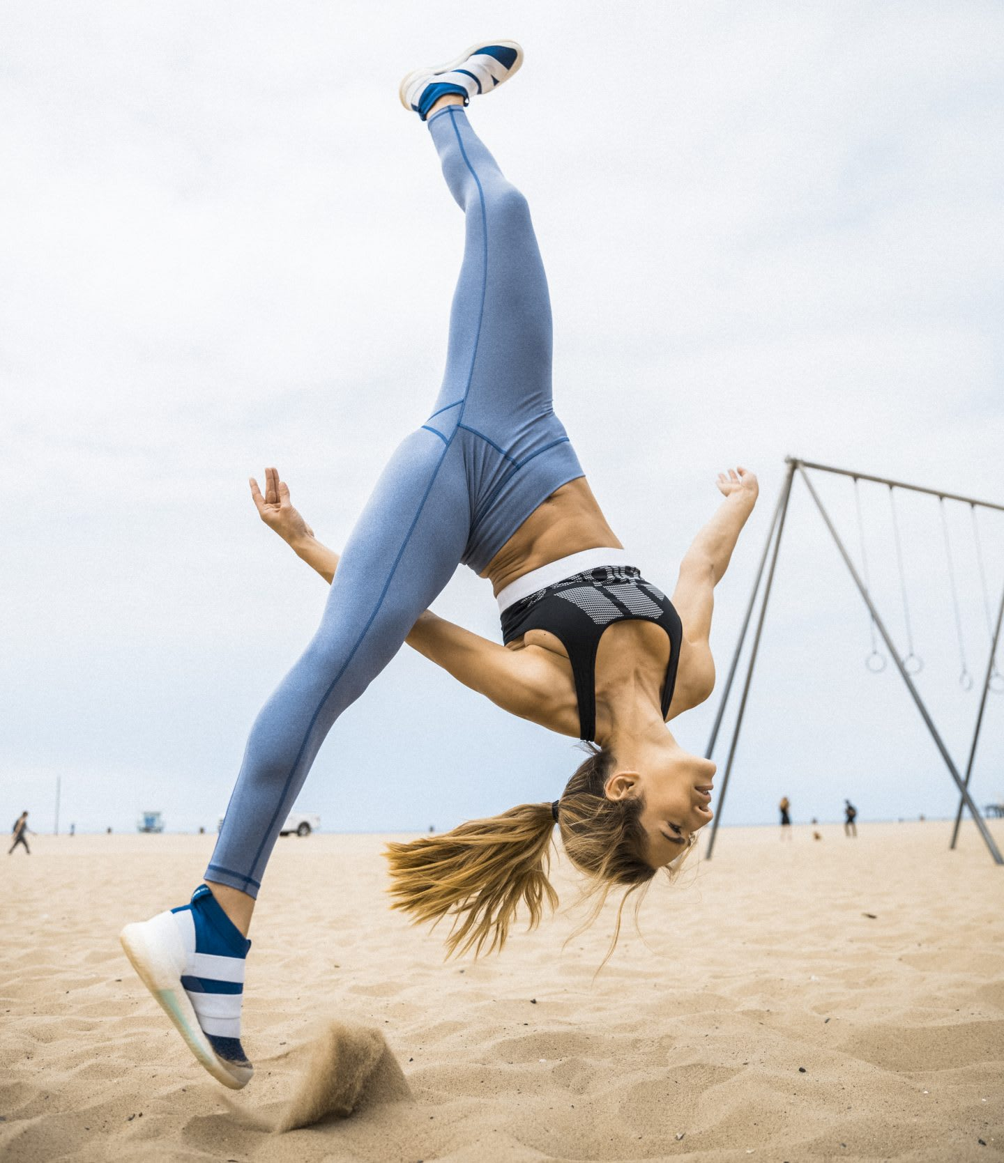 Woman doing a cartwheel showing body tension and bursting of energy, motivation, boost your performance, gymnastics, adidas, GamePlan A