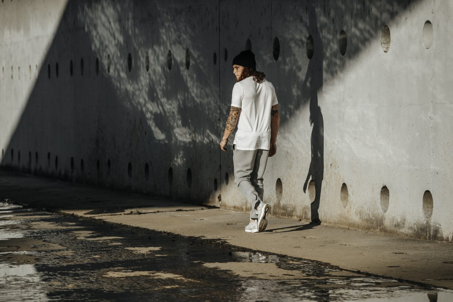 Guy walking on concrete in casual clothes after workout, urban environment, urban athlete, style, fashion, Reebok, GamePlan A