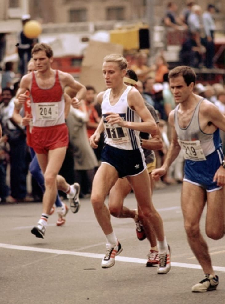 Grete Waitz female marathon athlete running New York Marathon among men on a street, marathon run, female runner, chase a goal, run against cancer, fighting against cancer, New York City Marathon, exercise oncology, physical activity, sports marketing, adidas, GamePlan A