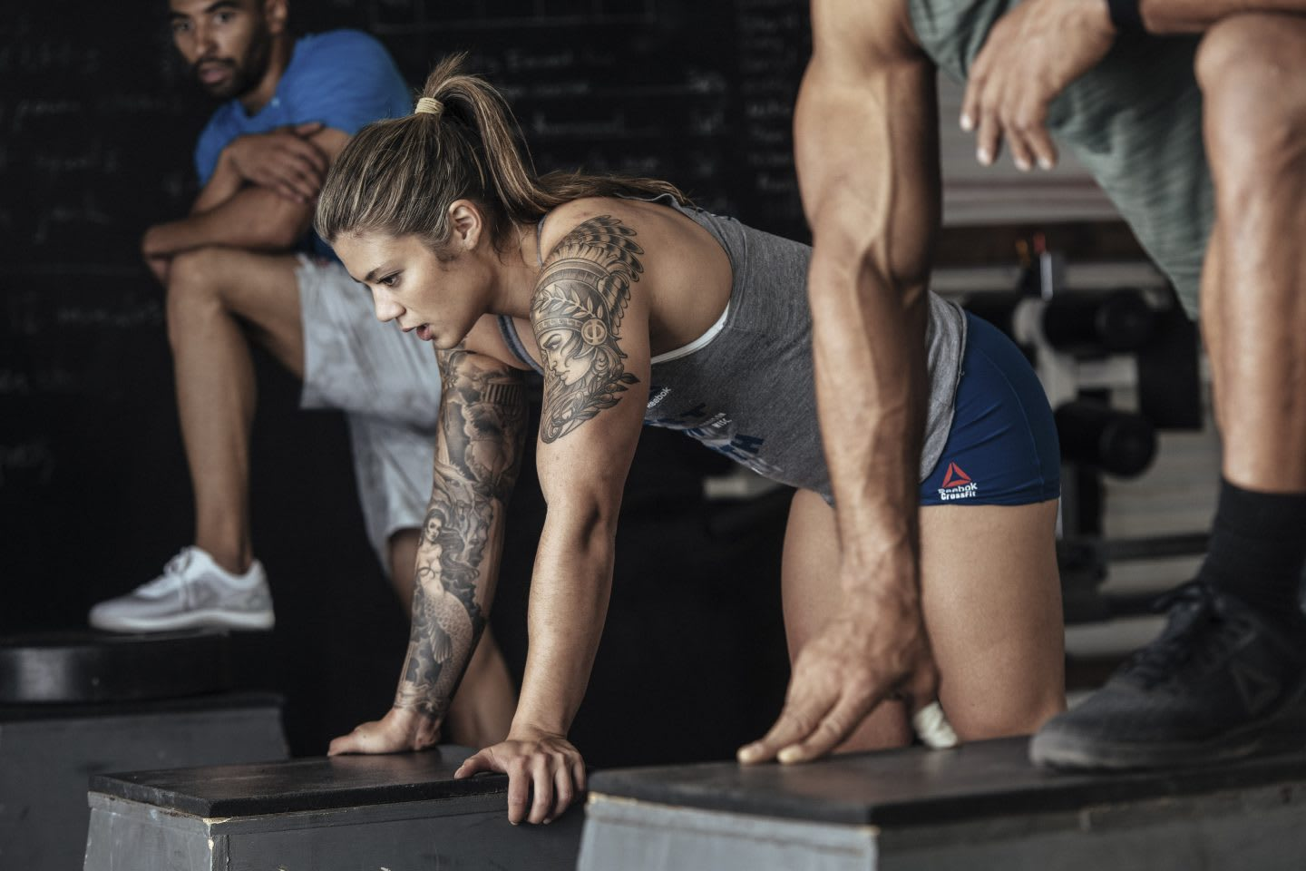 Girl resting after workout on bench, strong, physical strength, workout, challenge, sports, Reebok, crossFit, athlete, woman, sports marketing, GamePlan A