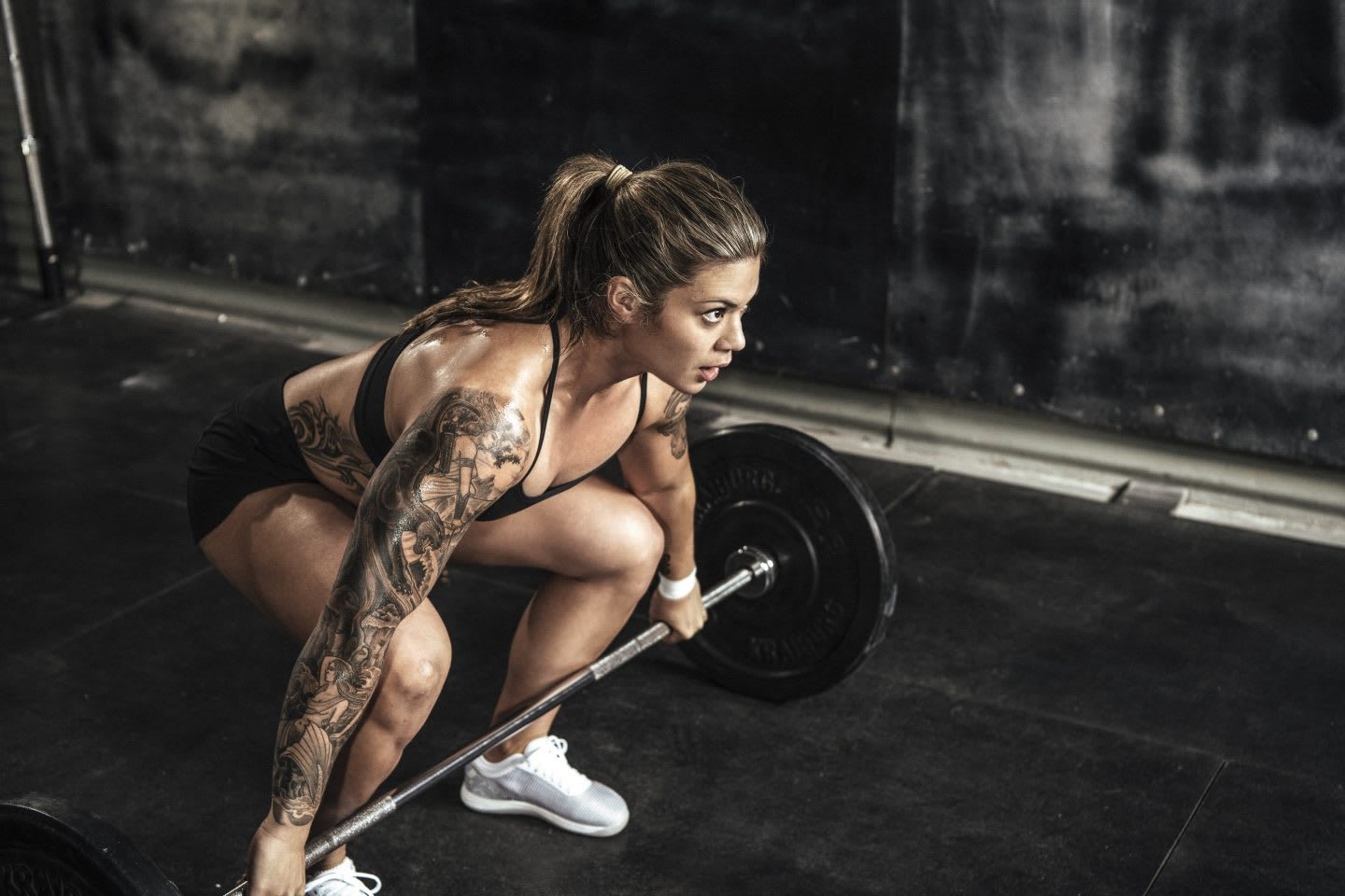 Girl bending down lifting weights, heavy, strong, workout, exercise, athlete, woman, Reebok, CrossFit, sports marketing, GamePlan A