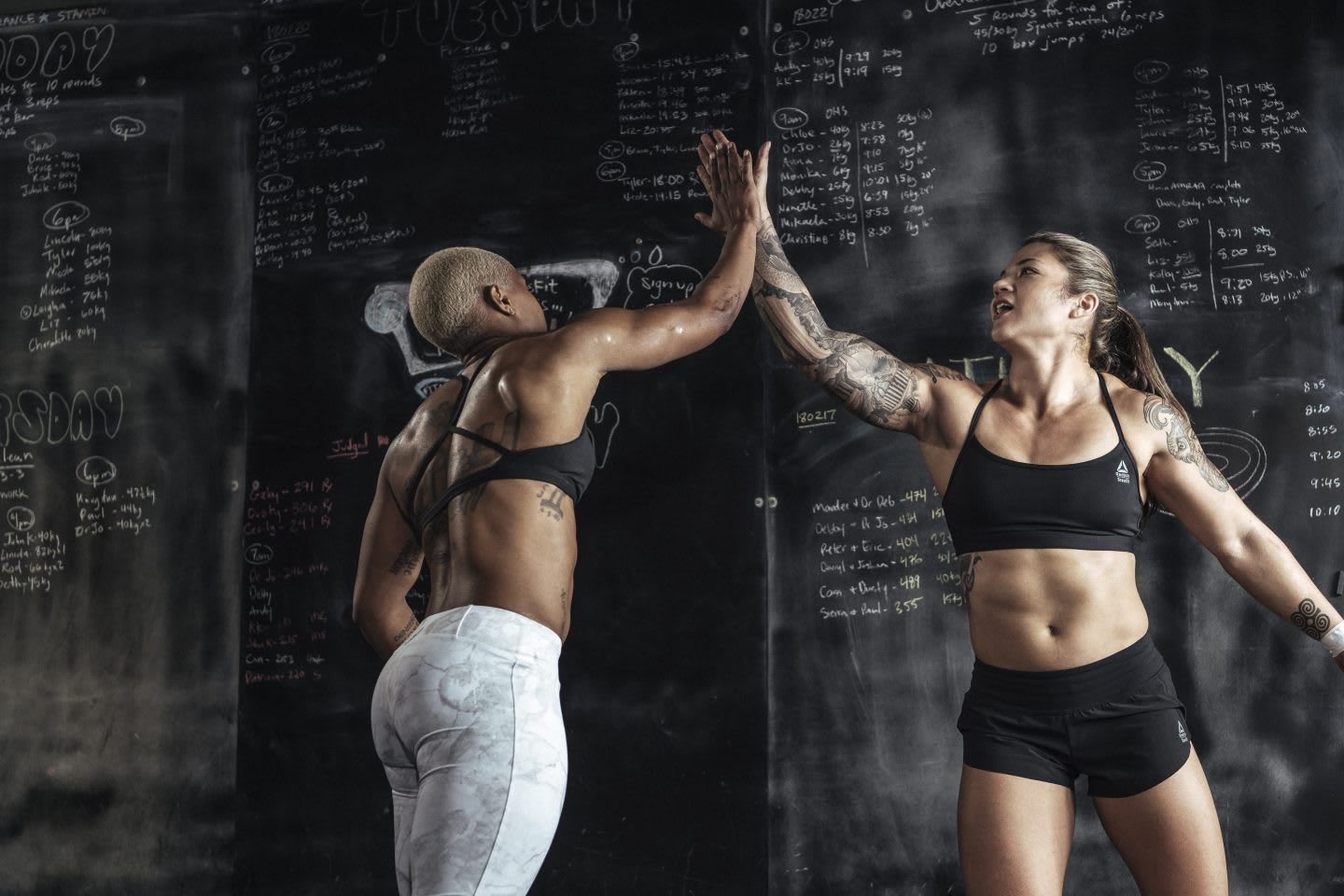 Girls high-fiving each other after doing a sports workout, achievement, success, motivation, emotional strength, passion, Reebok, CrossFit, athlete, sports marketing, GamePlan A
