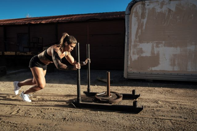 Girl pushing weights outdoor on a sandy ground, athlete, strong, workout, exercise, Reebok, CrossFit, sports marketing, GamePlan A