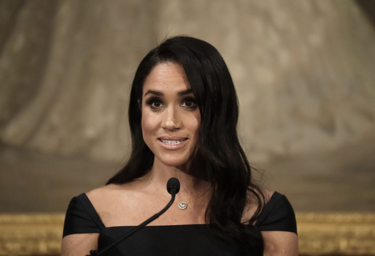 Meghan Markle talking into a microphone. diversity, gender equality, empowerment, women, GamePlan A