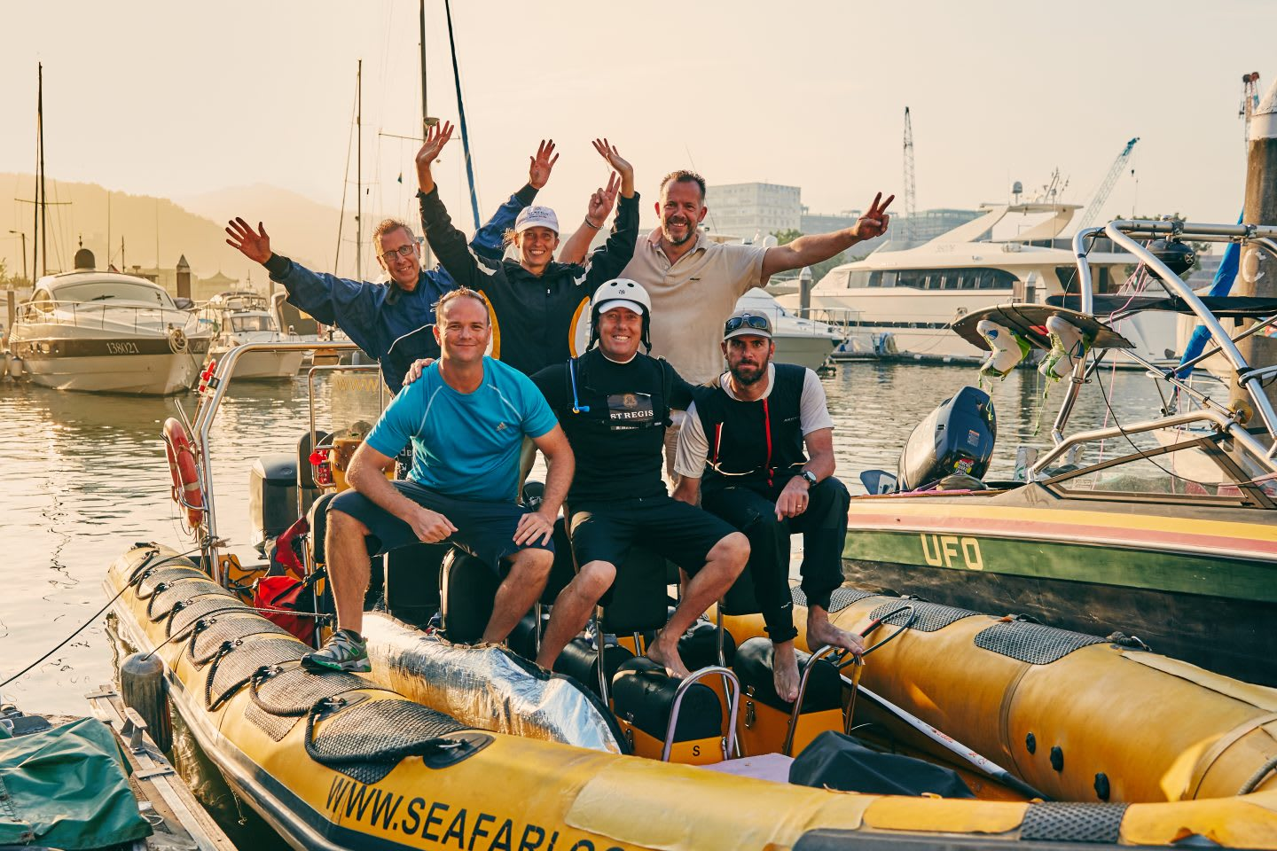 A team of sailors on a boat at the port. They smile into the camera. Nick Moloney, team, teamwork, sailing, career, success, preparation, motivation, mindset, GamePlan A