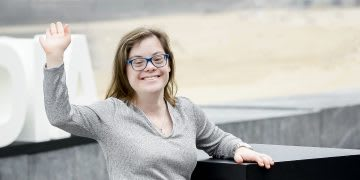 A woman with down syndrome smiling into the camera. career, actress, work-life balance