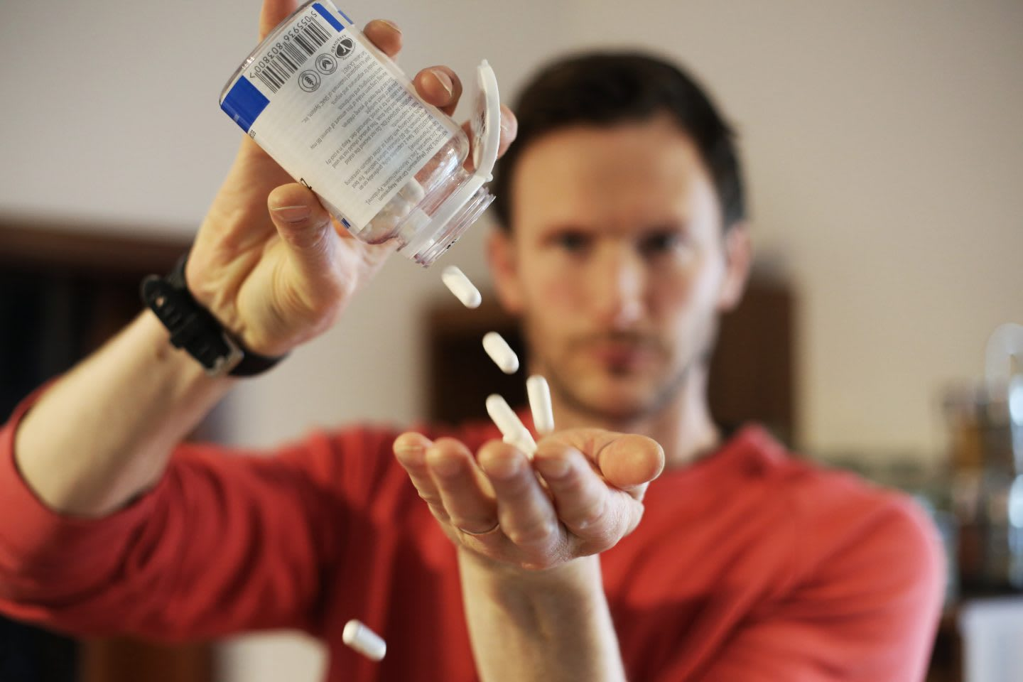 A guy putting a bunch of magnesium supplement pills into his hand. nutrition, health, supplements, magnesium, calm down, improve sleep, GamePlan A