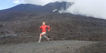 A woman running solo in hilly landscape. running, group, solo, coach, performance, development, GamePlan A