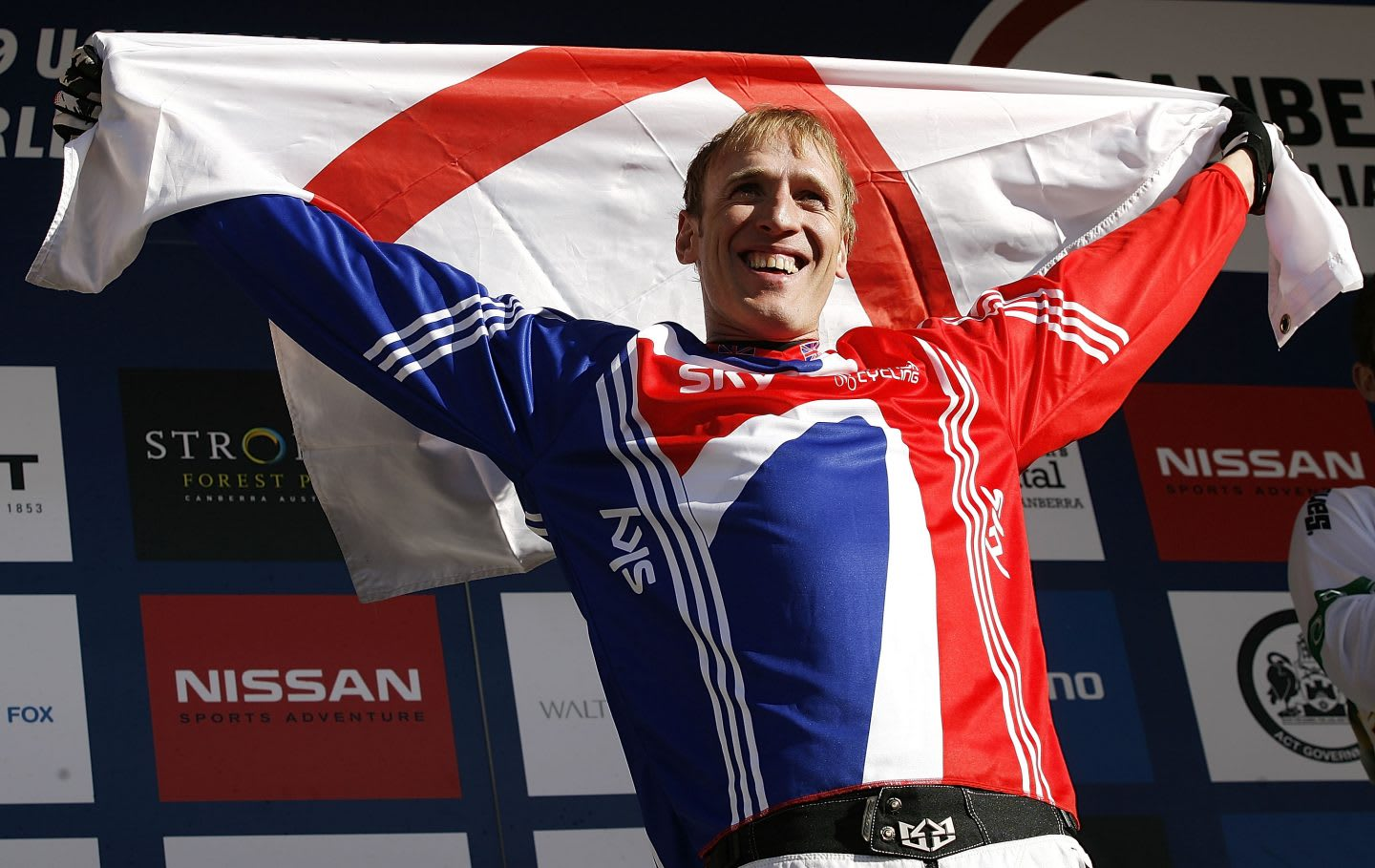 Steve Peat holding English flag in victory