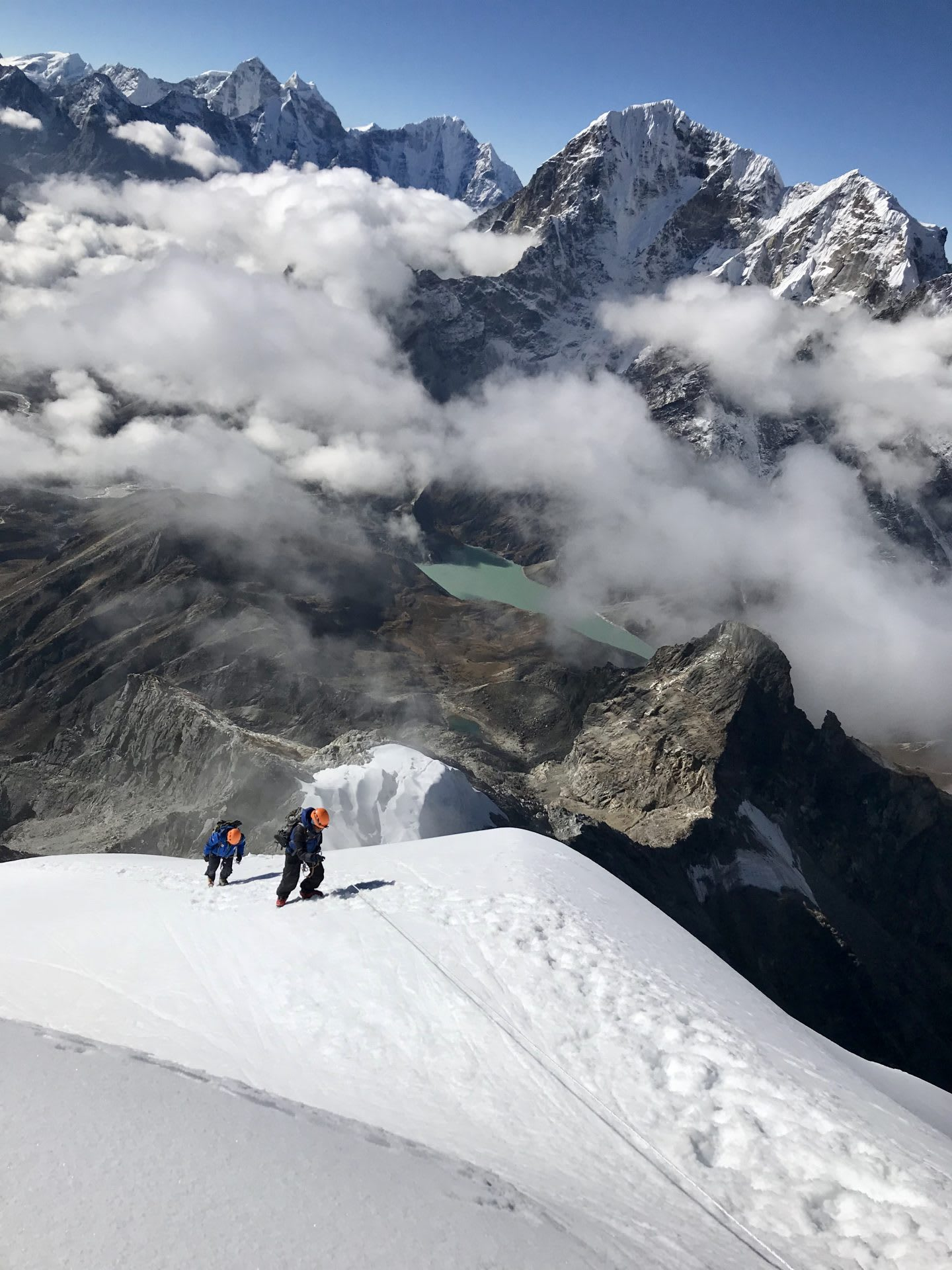 Marcel and his guide are walking over a snow field to climbing Everest.