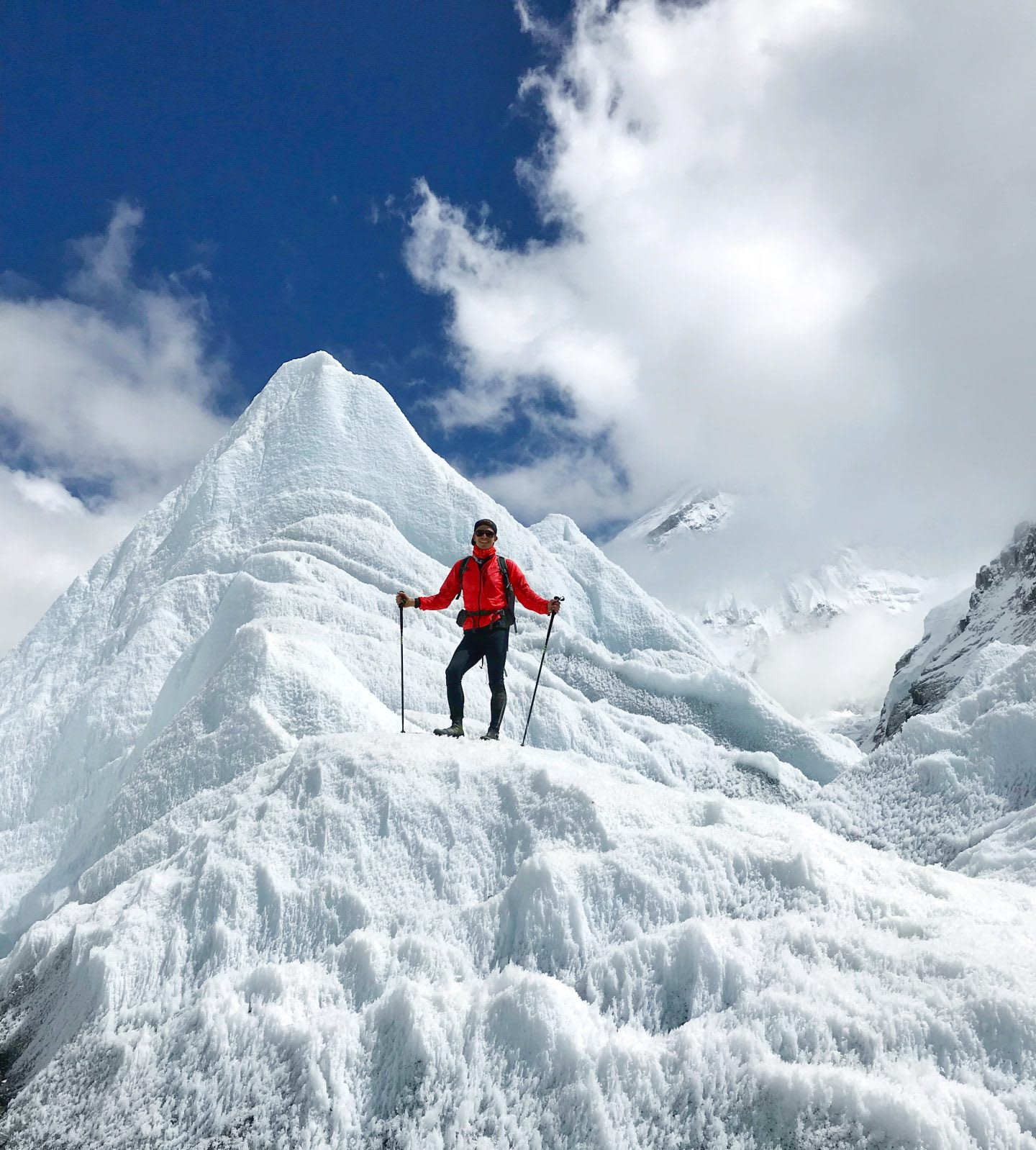 Marcel posing for a picture in the snow.   Climbing Everest