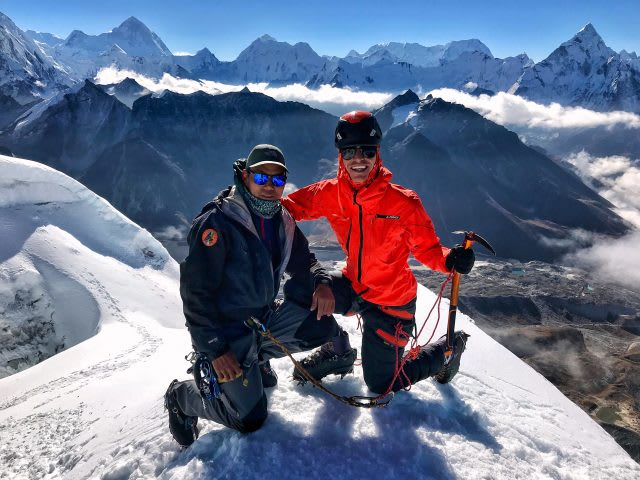 Marcel and his guide Domi on top of the Mount Everest smiling into the camera | Climbing Everest
