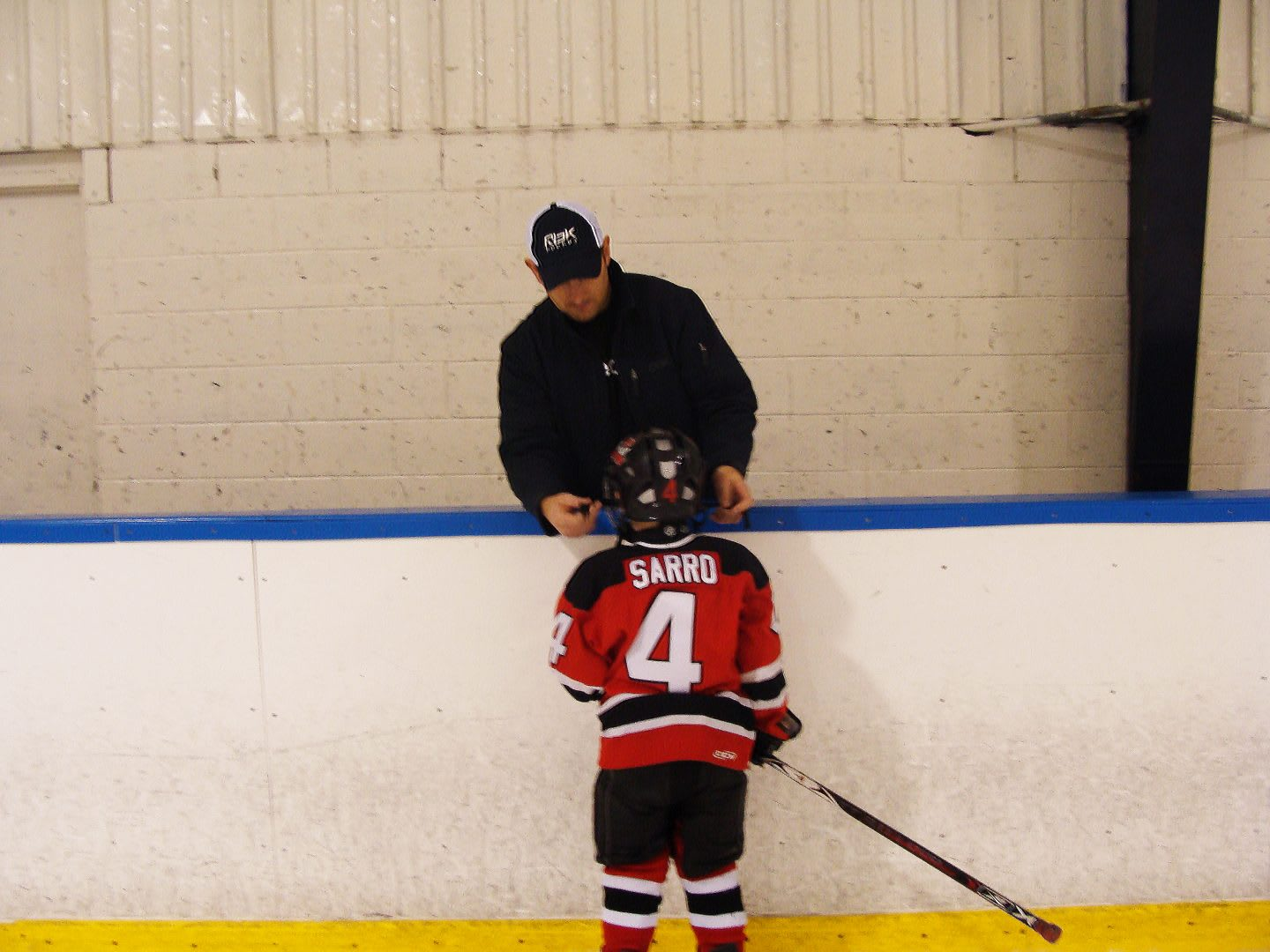Icehockey coach Dan Sarro coaching his so on the icehockey field