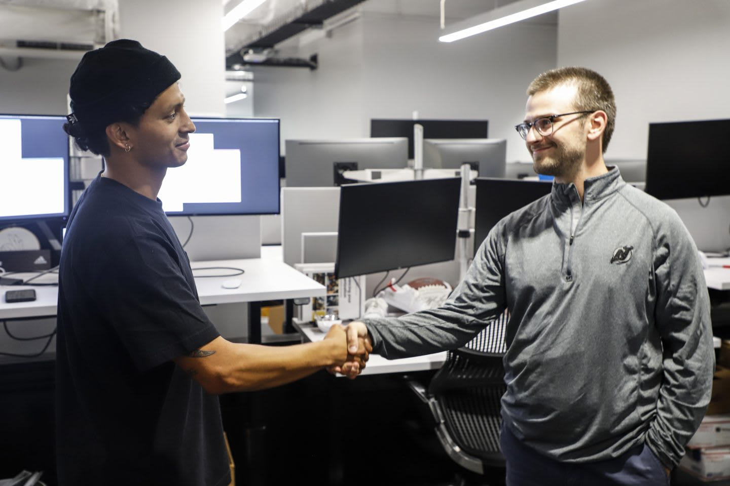 Two men shaking hands in the office at adidas. team, success, work, GamePlan A