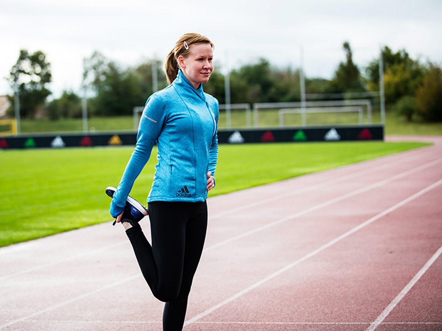 Female stretching on a running track. Dealing with grief. mindfulness, grief, self-reflection, GamePlan A.