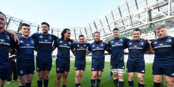 a team of rugby players standing on the pitch in a stadium. my career