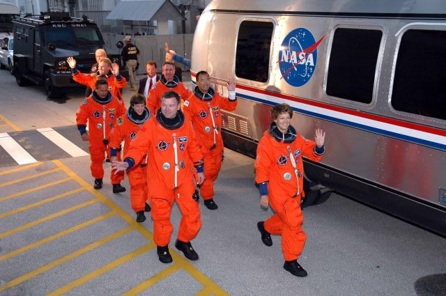 The crew of Discovery walking and waving into the camera in their space suits on their way to the NASA bus. diversity, innovation, creativity, team work, GamePlanA