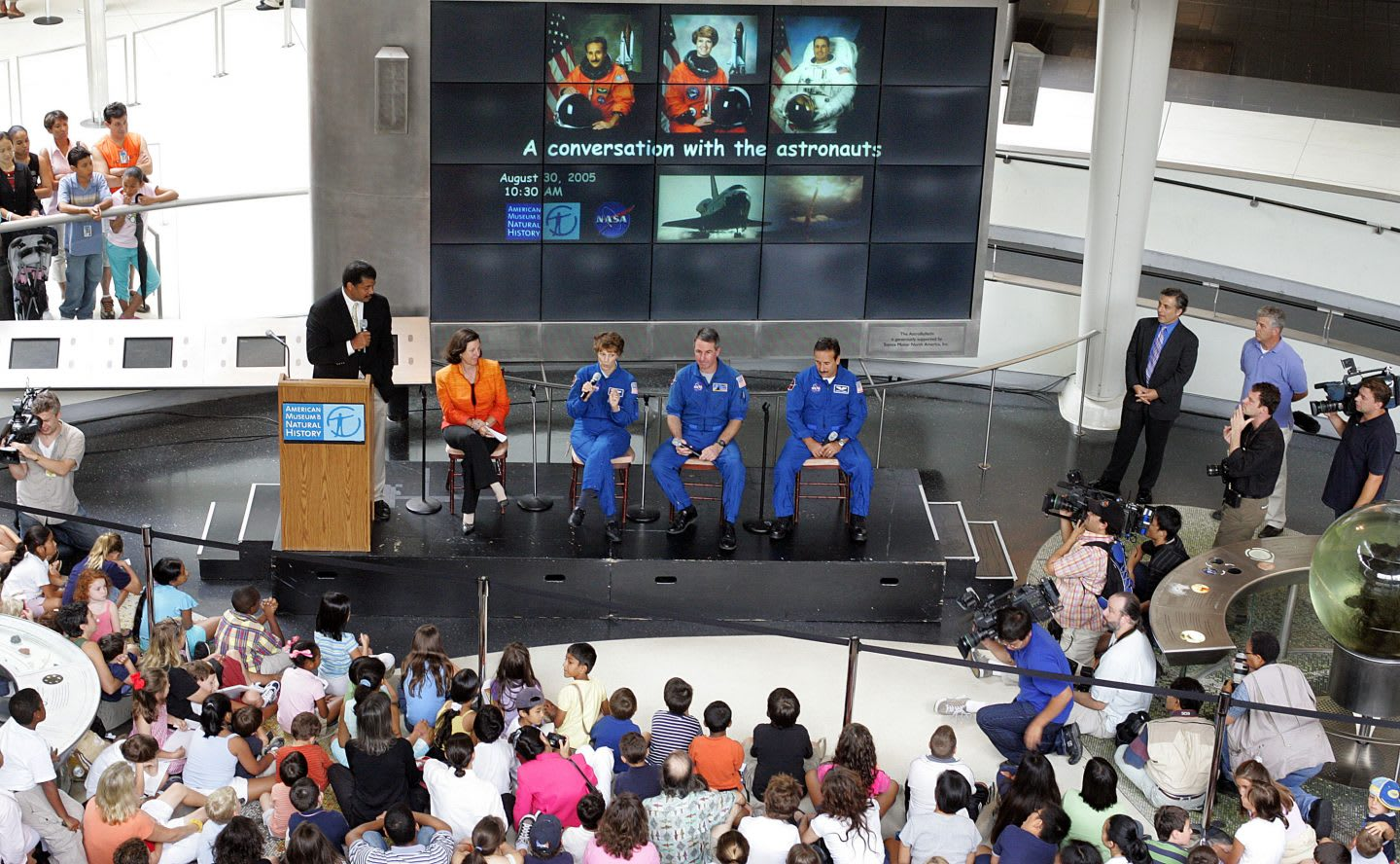 NASA astronauts in a talk round sitting on a podium in front of a crowd. diversity, innovation, creativity, team work, GamePlanA