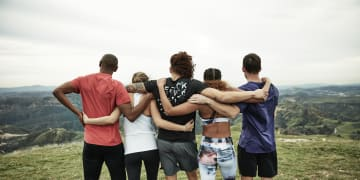 5 people in each others arms during exercise