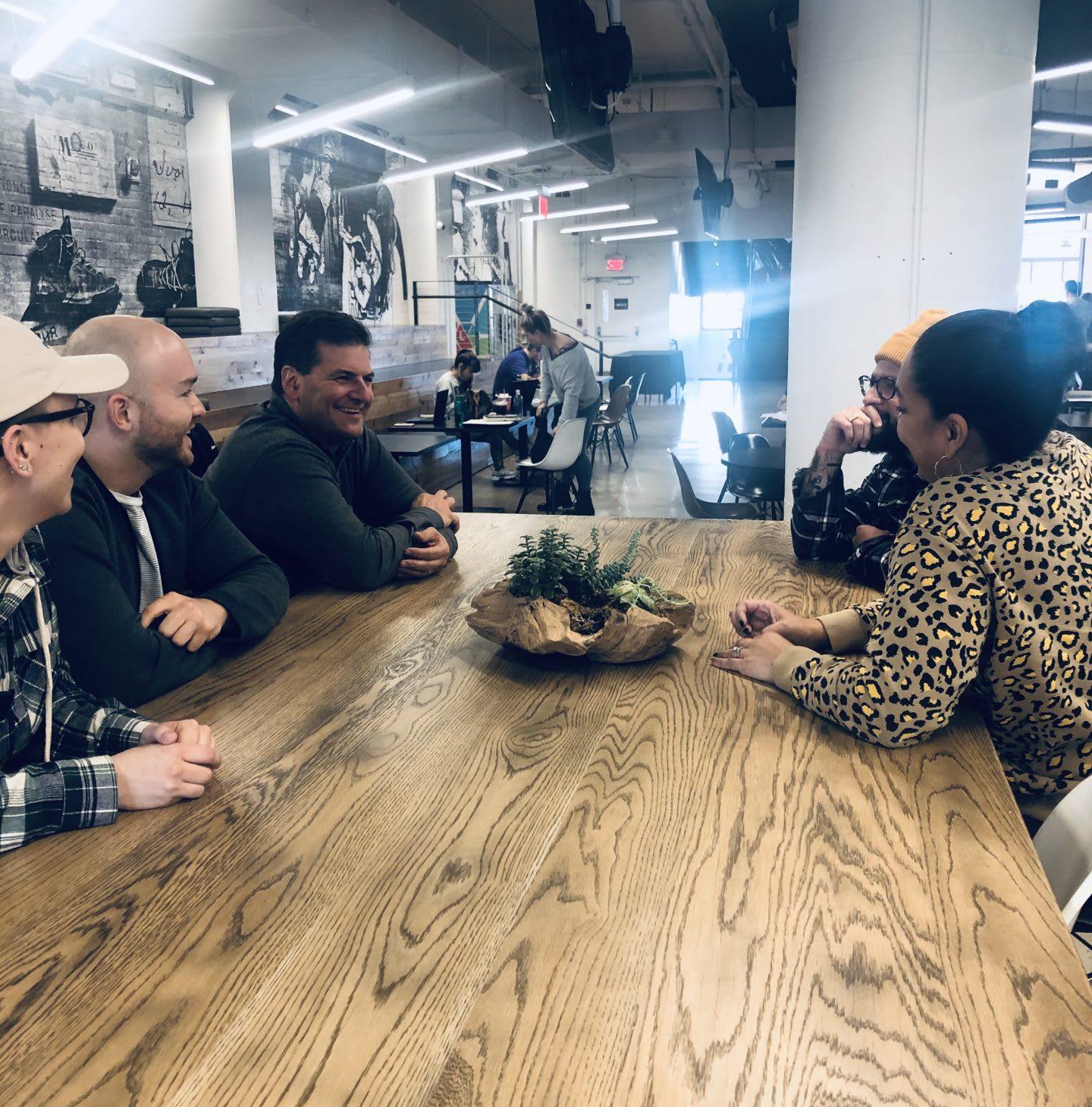 five people having a meeting, diversity