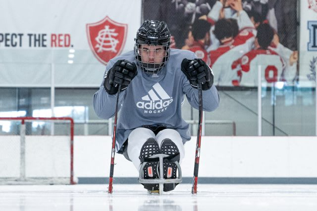 a disabled hockey player on a sled