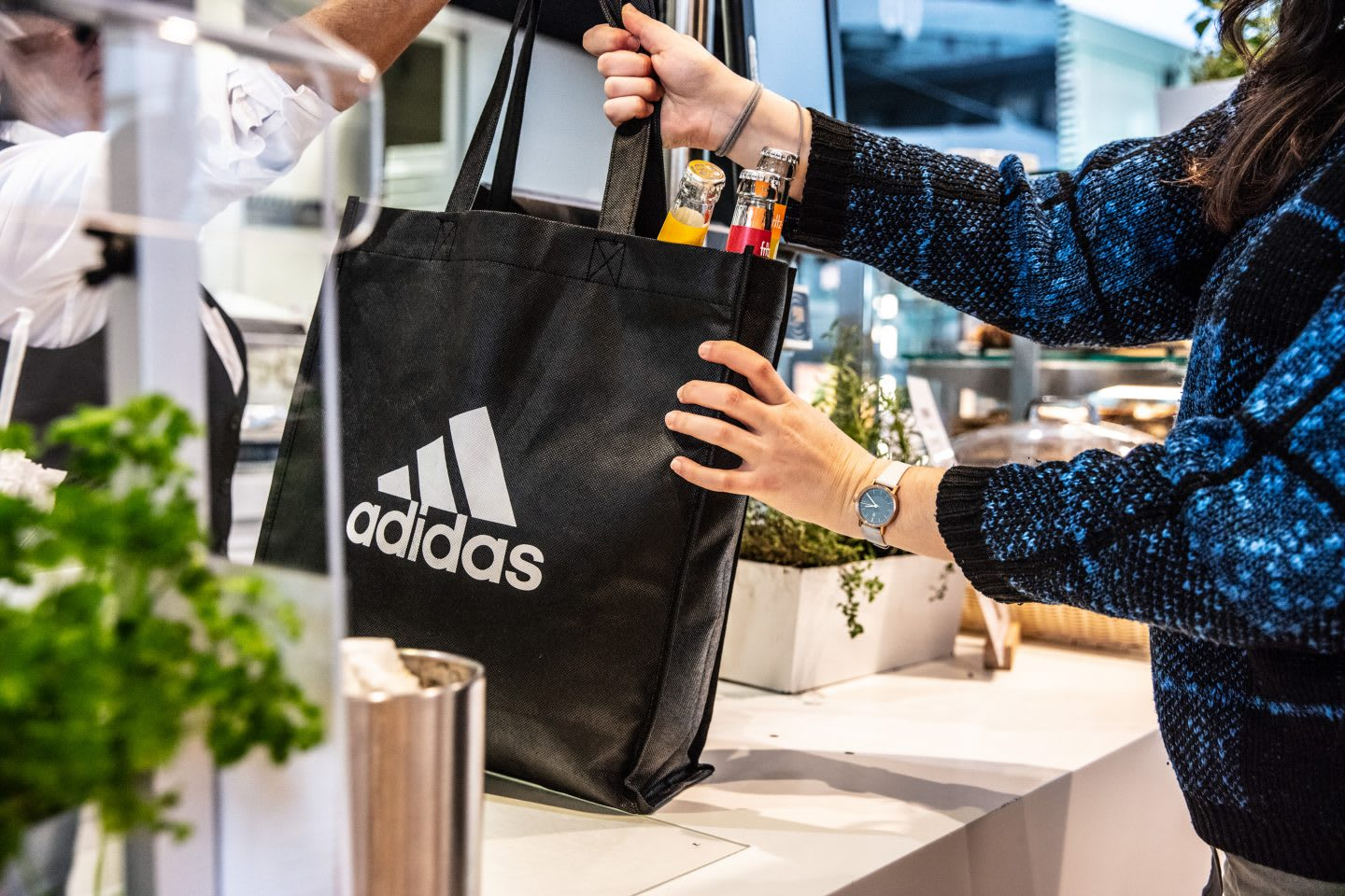 adidas reusable bag handed over the counter. avoid plastic, sustainability, habits and routines, inspiration, GamePlan A.
